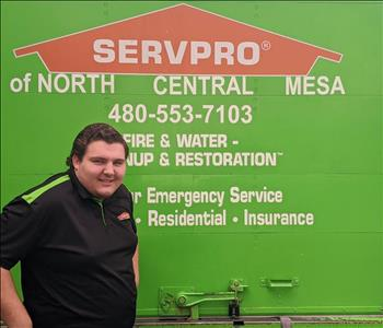 Dylan smiling as he is getting behind a SERVPRO Box truck