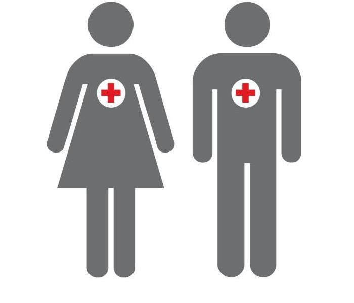 A male and female Volunteer side by side with American Red Cross symbols on them.
